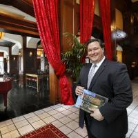 Photo -  The Skirvin Hilton General Manager Brett Sundstrom stands inside the front door of downtown's historic, iconic luxury hotel. Photo by Jim Beckel, The Oklahoman   Jim Beckel -  THE OKLAHOMAN