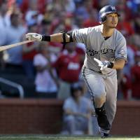 Photo -   Milwaukee Brewers' Norichika Aoki watches his two-run home run during the ninth inning of a baseball game against the St. Louis Cardinals, Sunday, Sept. 9, 2012, in St. Louis. The Cardinals won 5-4. (AP Photo/Jeff Roberson)