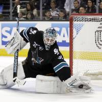 Photo -   San Jose Sharks goalie Antti Niemi, of Finland, deflects a shot on goal against the Los Angeles Kings during the scond period of an NHL hockey game Saturday, April 7, 2012 in San Jose, Calif. (AP Photo/Marcio Jose Sanchez)