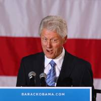 Photo -   Former President Bill Clinton, right, speaks at a rally for Barack Obama at Pullen Park in Raleigh, N.C., Sunday, Nov. 4, 2012, after being introduced by former North Carolina Governor Jim Hunt, left. The former president has been traveling to several battleground states over the past week to try to stem any Republican tide for Mitt Romney and preserve Obama leads. (AP Photo/Ted Richardson)