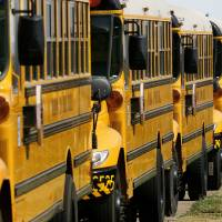 Photo - Oklahoma City school buses lined up at the district's transportation center in northeast Oklahoma City, Thursday,  Aug. 7, 2008.   BY JIM BECKEL, THE OKLAHOMAN ORG XMIT: KOD
