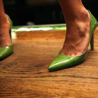 Photo -  A girl dances in high heels during the opening of Coyote Ugly in Oklahoma City Wednesday, June 24, 2009.  Photo by Ashley McKee, The Oklahoman