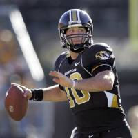 Photo - ** FILE ** Missouri quarterback Chase Daniel throws during a college football game against Texas Tech in this Oct. 20, 2007 file photo, in Columbia, Mo. (AP Photo/Jeff Roberson) ORG XMIT: NY170