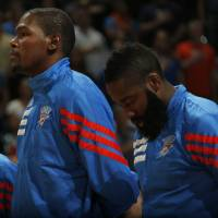 Photo - Oklahoma City's Kevin Durant (35) and James Harden (13) stand during the National Anthem before the preseason NBA game between the Oklahoma City Thunder and the Charlotte Bobcats at Chesapeake Energy Arena in Oklahoma City, Tuesday, Oct. 16, 2012. Photo by Sarah Phipps, The Oklahoman