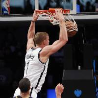 Photo - Brooklyn Nets forward Mason Plumlee (1) stuffs a basket in the first half of an NBA basketball game against the New Orleans Pelicans on Sunday, Feb. 9, 2014, in New York. (AP Photo/Paul J. Bereswill)