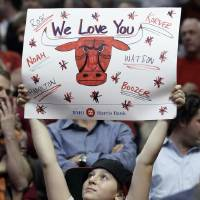 Photo -   A Chicago Bulls fan holds a sign during the second quarter of Game 5 in an NBA basketball first-round playoff series between the Bulls and the Philadelphia 76ers in Chicago on Tuesday, May 8, 2012. (AP Photo/Nam Y. Huh)