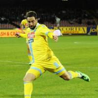 Photo - Napoli's Gonzalo Higuaín shoots at the goal during an Italian Cup Cup quarterfinal soccer match between Napoli and Lazio, at the San Paolo stadium in Naples, Italy, Wednesday, Jan. 29, 2014. (AP Photo/Salvatore Laporta)