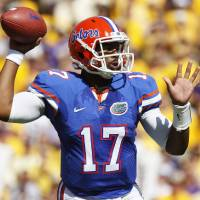 Photo - FILE - In this Oct.  8, 2011 file photo,  Florida quarterback Jacoby Brissett (17) throws a pass in the first half of an NCAA college football game against LSU in Baton Rouge, La. Brissett knows he will face big expectations when he finally takes a snap for North Carolina State. Brissett, who has two years of eligibility remaining, takes over a team that won three games and went winless in the Atlantic Coast Conference for the first time since 1959. (AP Photo/Jonathan Bachman, File)