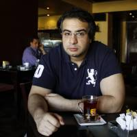 Photo - This June 29, 2012 photo shows Egyptian blogger Bassem Sabry during a newspaper interview in Cairo, Egypt. Sabry, one of Egypt's most respected bloggers and a democracy advocate who chronicled the country's turmoil since the 2011 uprising that ousted autocrat Hosni Mubarak, has died. He was 31. (AP Photo/Mohamed Nouhan, El Shorouk newspaper) EGYPT OUT