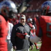 Photo - Rutgers defensive coordinator Dave Cohen watches his players warm-up before an NCAA college football game against Cincinnati in Piscataway, N.J., Saturday, Nov. 16, 2013. (AP Photo/Mel Evans)