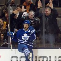 Photo - Toronto Maple Leafs center Jay McClement celebrates his goal against the New Jersey Devils during the third period of their NHL hockey game, Monday, March 4, 2013, in Toronto. The Maple Leafs won 4-2. (AP Photo/The Canadian Press, Frank Gunn)