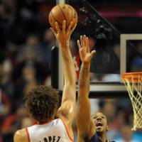 Photo - Portland Trail Blazers center Robin Lopez (42) shoots over Phoenix Suns power forward Channing Frye (8) during the first quarter of an NBA basketball game on Wednesday, Nov. 13, 2013, in Portland, Ore. (AP Photo/Steve Dykes)