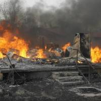 Photo -  A burned home was in the path of wildfires which destroyed 12 structures in Lindsay, Okla. on Thursday, April 9, 2009. Photo by Steve Sisney