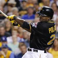 Photo - Pittsburgh Pirates' Gregory Polanco (25) drives in two runs with a bases loaded single off Los Angeles Dodgers relief pitcher Jamey Wright during the sixth inning of a baseball game in Pittsburgh Tuesday, July 22, 2014. (AP Photo)