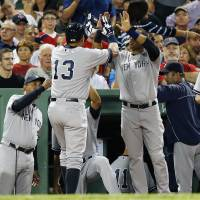 Photo - New York Yankees' Alex Rodriguez (13) celebrates with teammate Robinson Cano, center right, after scoring on a single by Eduardo Nunez in the second inning of a baseball game against the Boston Red Sox in Boston, Sunday, Aug. 18, 2013. (AP Photo/Michael Dwyer)