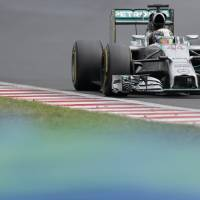 Photo - Mercedes driver Lewis Hamilton of Britain steers his car during the Hungarian Formula One Grand Prix in Budapest, Hungary, Sunday, July 27, 2014. (AP Photo/Petr David Josek)