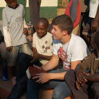 Photo - Oklahoma Baptist University student Joseph Hefner, right center, a sophomore youth ministry major from Denison, Texas, leads a Bible study for the children of the New Day Orphanage in Mapanza, Zambia. Photo Provided