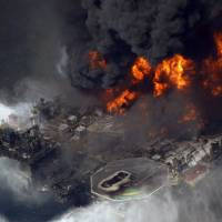 Photo - FILE - In this April 21, 2010 aerial file photo taken in the Gulf of Mexico more than 50 miles southeast of Venice, La., the Deepwater Horizon oil rig is seen burning. A U.S. judge on Tuesday, Jan. 29, 2013, approved an agreement for British oil giant BP PLC to plead guilty to manslaughter and other charges and pay a record $4 billion in criminal penalties for the company's role in the 2010 oil disaster in the Gulf of Mexico. (AP Photo/Gerald Herbert, File)