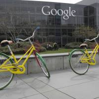 Photo - Google bicycles are shown March 15 at the Google campus in Mountain View, Calif.  AP Photo