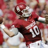 Photo - Oklahoma's Blake Bell (10) prepares to throw the ball during the college football game between the University of Oklahoma Sooners (OU) and the University of Tulsa Hurricanes (TU) at the Gaylord-Family Oklahoma Memorial Stadium on Saturday, Sept. 14, 2013 in Norman, Okla.  Photo by Chris Landsberger, The Oklahoman