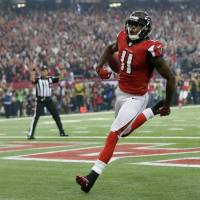 Photo - Atlanta Falcons' Julio Jones runs into the end zone after catching a 46-yard touchdown pass during the first half of the NFL football NFC Championship game against the San Francisco 49ers Sunday, Jan. 20, 2013, in Atlanta. (AP Photo/Dave Martin)