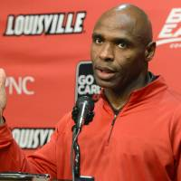 Photo - Louisville head football coach Charlie Strong addresses reporters during a news conference Thursday, Dec. 6, 2012, in Louisville, Ky. Strong turned down the job offer with the University of Tennessee to stay at Louisville.  (AP Photo/Timothy D. Easley)