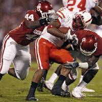 Photo - Nebraska's Marlon Lucky (5) is brought down by  Oklahoma's Jeremy Beal (44) and Brian Jackson (2) during the first half of the college football game between the University of  Oklahoma Sooners (OU) and the University of Nebraska Huskers (NU) at the Gaylord Family Memorial Stadium, on Saturday, Nov. 1, 2008, in Norman, Okla. BY STEVE SISNEY, THE OKLAHOMAN