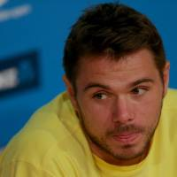 Photo - Switzerland's Stanislas Wawrinka  answer's questions at a press conference at the Australian Open tennis championship in Melbourne, Australia, Saturday, Jan. 25, 2014. Wawrinka will play Spain's Rafael Nadal in the men's singles final Sunday. (AP Photo/Eugene Hoshiko)