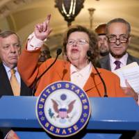 Photo - FILE - This Aug. 1, 2013, file photo shows Senate Appropriations Committee Chair  Sen. Barbara Mikulski, D-Md., flanked by Senate Majority Whip Richard Durbin of Ill., left, and Sen. Charles Schumer, D-N.Y., speaking on Capitol Hill in Washington.  Top congressional negotiators released on Jan. 13, 2014, a bipartisan $1.1 trillion spending bill that would pay for the operations of government through October and finally put to rest the bitter budget battles of last year. The 1,582-page bill was released after weeks of negotiations between House Appropriations Committee Chairman Harold Rogers, R-Ky., and Senate counterpart Mikulski, who kept a tight lid on the details. (AP Photo/J. Scott Applewhite, File)