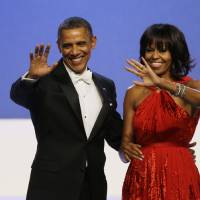 Photo - FILE - In this Jan. 21, 2013, file photo, President Barack Obama and Michelle Obama wave to guests after their dance at the Inaugural Ball at the 57th Presidential Inauguration in Washington. Michelle Obama has a new look, both in person and online, and with the president's re-election, she has four more years as first lady, too. The first lady is trying to figure out what comes next for this self-described