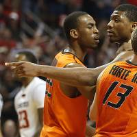 Photo - Oklahoma State's Markel Brown(22) and Phil Forte(13) hold Marcus Smart(33) after Smart shoved a fan during their NCAA college basketball game in Lubbock, Texas, Saturday, Feb, 8, 2014. (AP Photo/Lubbock Avalanche-Journal, Tori Eichberger) ALL LOCAL TV OUT