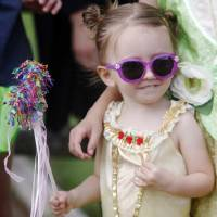 Photo -  Eliza Feisal, 2, looks for her parents after taking a photo after the children's parade at the Bethany 66 Festival. Photo by K.T. King, The Oklahoman    KT King -