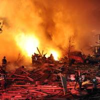 Photo -   Firefighters work the scene where an explosion has killed two people and damaged more than a dozen homes in the Richmond Hill subdivision, late Saturday, Nov. 10, 2012, in Indianapolis. (AP Photo/The Indianapolis Star, Matt Kryger) NO SALES