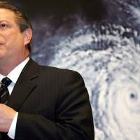 Photo -   FILE - In this Monday, Jan. 15, 2007 file photo, former U.S. Vice President Al Gore speaks in front of a poster for his documentary film on global warming,