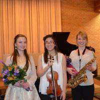 Photo - Charlotte Dumesnil, left, Sarah McKiddy, and Katie Duncan after their trio performance at the OSU Bennett Chapel in preparation for the national round of a California competition.   - Photo Provided