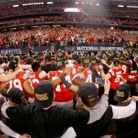 ARLINGTON, TX - JANUARY 12:  The Ohio State Buckeyes celebrate after defeating the Oregon Ducks 42 to 20 in the College Football Playoff National Championship Game at AT&T Stadium on January 12, 2015 in Arlington, Texas.  (Photo by Christian Petersen/Getty Images)