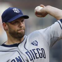 Photo - San Diego Padres starting pitcher Eric Stults throws against the Pittsburgh Pirates in the first inning of the baseball game on Saturday, Aug. 9, 2014, in Pittsburgh. (AP Photo/Keith Srakocic)