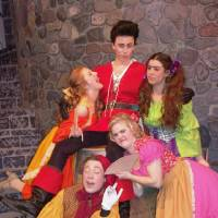 Photo - Gaston (Joel Anderson), the Silly Girls (Karly Hazelrigg, Cassidy Gierhart and Mackenzie Kulig) and LeFou (Alan Beck) pose for a group photo. Choctaw High School's production of