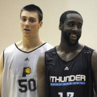 Photo - Indiana Pacers forward Tyler Hansbrough, left, and Oklahoma City Thunder guard James Harden laugh during the second half of a summer league NBA basketball game in Maitland, Fla., Tuesday, July 7, 2009. (AP Photo/Phelan M. Ebenhack) ORG XMIT: FLPE105