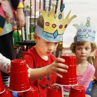 Photo - Kindergartner Cade Smith, 6, built a tower out of 100 plastic cups to celebrate the 100th day of school at James L. Dennis Elementary.  Photos by Paul B. Southerland, The Oklahoman