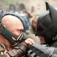 "Photo -  (L-r) TOM HARDY as Bane and CHRISTIAN BALE as Batman in Warner Bros. Pictures' and Legendary Pictures' action thriller ""THE DARK KNIGHT RISES,"" a Warner Bros. Pictures release. TM and © DC Comics"