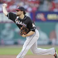 Photo - Miami Marlins starting pitcher Nathan Eovaldi delivers in the second inning of a baseball game against the St. Louis Cardinals, Friday, July 4, 2014, in St. Louis.(AP Photo/Tom Gannam)