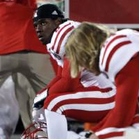 Photo -   Nebraska's Ameer Abdullah, left, sits on the bench as time runs out in their loss to Ohio State in an NCAA college football game, Saturday, Oct. 6, 2012, in Columbus, Ohio. Ohio State defeated Nebraska 63-38. (AP Photo/Jay LaPrete)