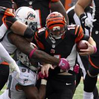 Photo -   Cincinnati Bengals quarterback Andy Dalton (14) is sacked by Miami Dolphins defensive end Cameron Wake (91) in the second half of an NFL football game on Sunday, Oct. 7, 2012, in Cincinnati. (AP Photo/Tom Uhlman)