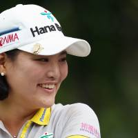 Photo - So Yeon Ryu, of South Korea, smiles during a delay in action on the third hole during second round play at the Canadian Pacific Women's Open golf tournament in London, Ontario, Friday, Aug. 22, 2014. (AP Photo/The Canadian Press, Dave Chidley)