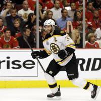 Photo - Boston Bruins center Patrice Bergeron (37) celebrates after scoring a goal against the Chicago Blackhawks during the third period of Game 1 in their NHL Stanley Cup Final hockey series on Wednesday, June 12, 2013, in Chicago. (AP Photo/Nam Y. Huh)
