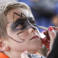 Photo - Nine year old Kaleb Ethridge has his face painted during the Jones Old Timers Day celebration in Jones, OK, Saturday, October 6, 2012,  By Paul Hellstern, The Oklahoman
