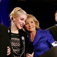 Photo - Governor Elect Mary Fallin shares a moment with her daughter Christina (center) her husband Wade Christensen (right and her son Price Fallin during the Republican Watch Party at the Marriott in Oklahoma City on Tuesday, Nov. 2, 2010.Photo by  John  Clanton