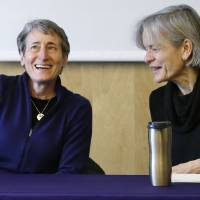 Photo - U.S. Interior Secretary Sally Jewell, left, talks with Lisa Graumlich, dean of the College of the Environment, before beginning a roundtable discussion at the University of Washington, Tuesday, Feb. 4, 2014, in Seattle. As part of President Obama's Climate Action Plan to cut carbon pollution, develop domestic clean energy sources and create American jobs, the gathering focused on climate change impacts to the Pacific Northwest. (AP Photo/Elaine Thompson)