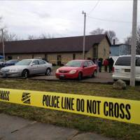 Photo - This image provided by WKYC, Channel 3, shows the scene outside a church in Ashtabula, Ohio, on Sunday, March 31, 2013. Police in northeast Ohio are investigating a shooting outside the church that has reportedly left one man dead after an Easter service. (AP Photo/WKYC)